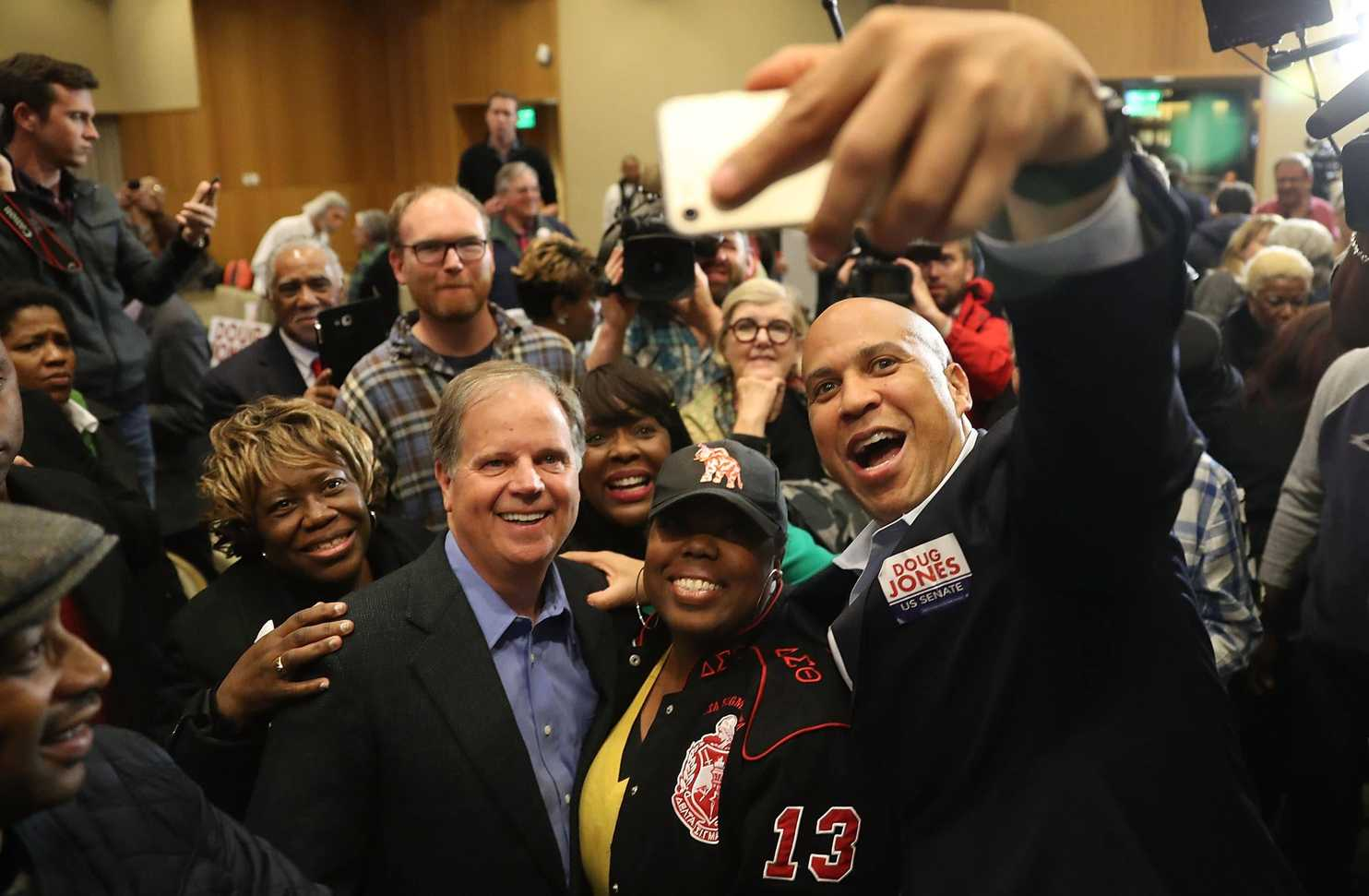 Soon to-be-elected US Sen. Doug Jones (D-Alabama) with women voters who made the upset possible last night, and Sen. Cory Booker (D-New Jersey) campaigning in Alabama—where Roy Moore was soundly defeated despite Steve Bannon and Donald Trump campaigning for the accused girl-stalker.