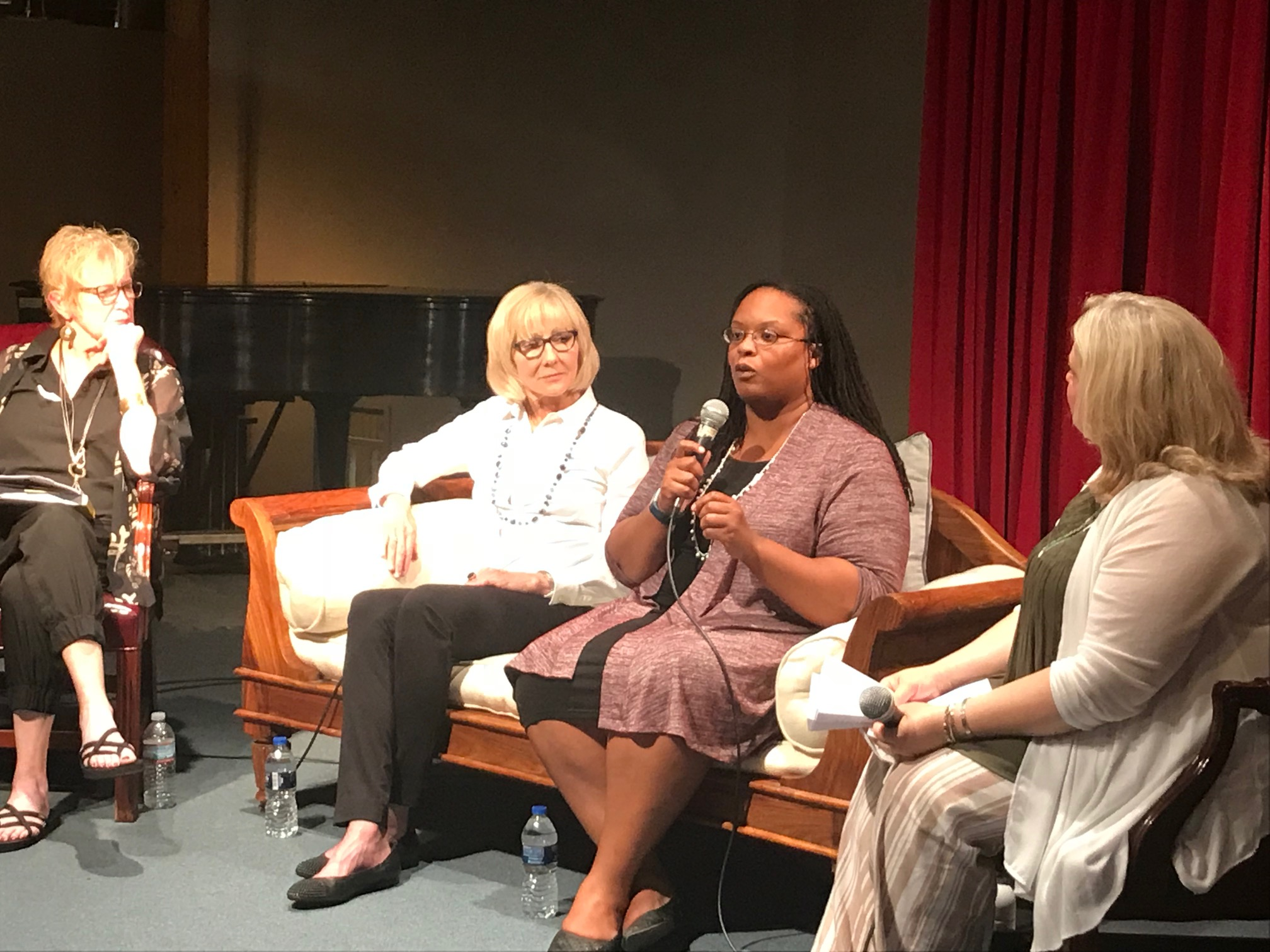 (l.to r.) Rickey Gard Diamond, author of Screwnomics; Linda Gartz, author of Redlined, Elizabeth McCree, Benton Harbor, Michigan attorney, and Kim Jorgensen Gane, St. Joseph, Michigan realtor, discuss the real life results of economic policies with an audience at The Box Factory in St. Joseph, July 31, 2018. Ami Hendrickson (not pictured) co-hosted the event, and reported on it at MuseInks.