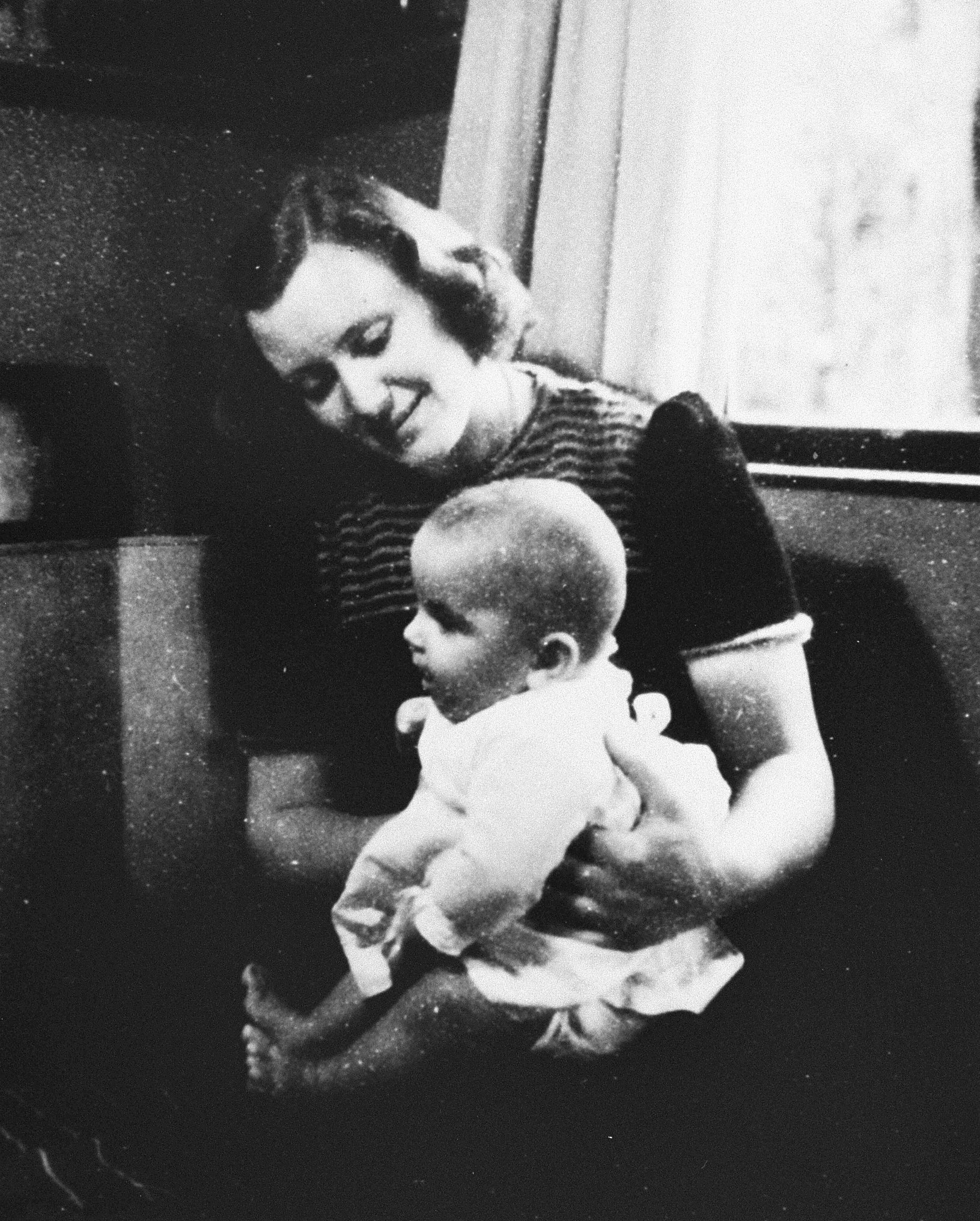 "Marian Pritchard with Erica Polak, a Jewish baby she was hiding in 1944. Part of the Dutch resistance under Nazi occupation, Pritchard later told an audience at a 1996 lecture at University of Michigan: ""By 1945, I had lied, stolen, cheated, deceived and even killed.""."" (photo from the US Holocaust Memorial Museum)"