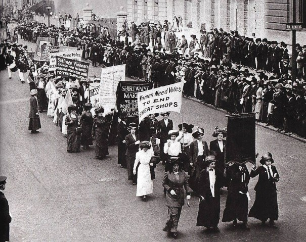 This photo shows a woman with a sign that mentions the Shirtwaist Factory, a reference to the deadly New York City fire that took the lives of 145 women seamstresses in 1911. But as early as 1908, working women were organizing and marching for better working conditions and pay, and still we're waving signs in the streets, believing a better world with women's say-so is not only possible, but essential.