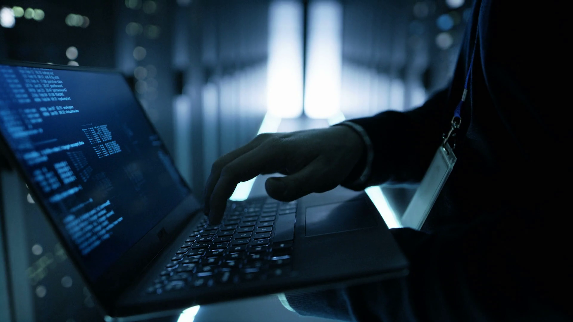 videoblocks-it-specialist-working-working-on-a-laptop-hes-employee-of-big-ultramodern-data-center-shot-on-red-epic-w-8k-helium-cinema-camera_btrh9p83l_thumbnail-full01.png