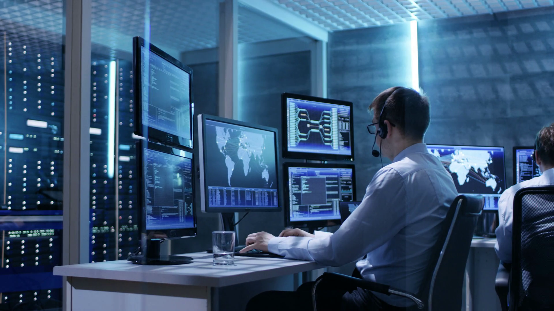 videoblocks-panorama-shot-of-system-control-room-with-three-technical-controllers-working-at-their-workstations-with-multiple-displays-shot-on-red-epic-w-8k-helium-cinema-camera_bxj_vrorx_thumbnail-full01.png