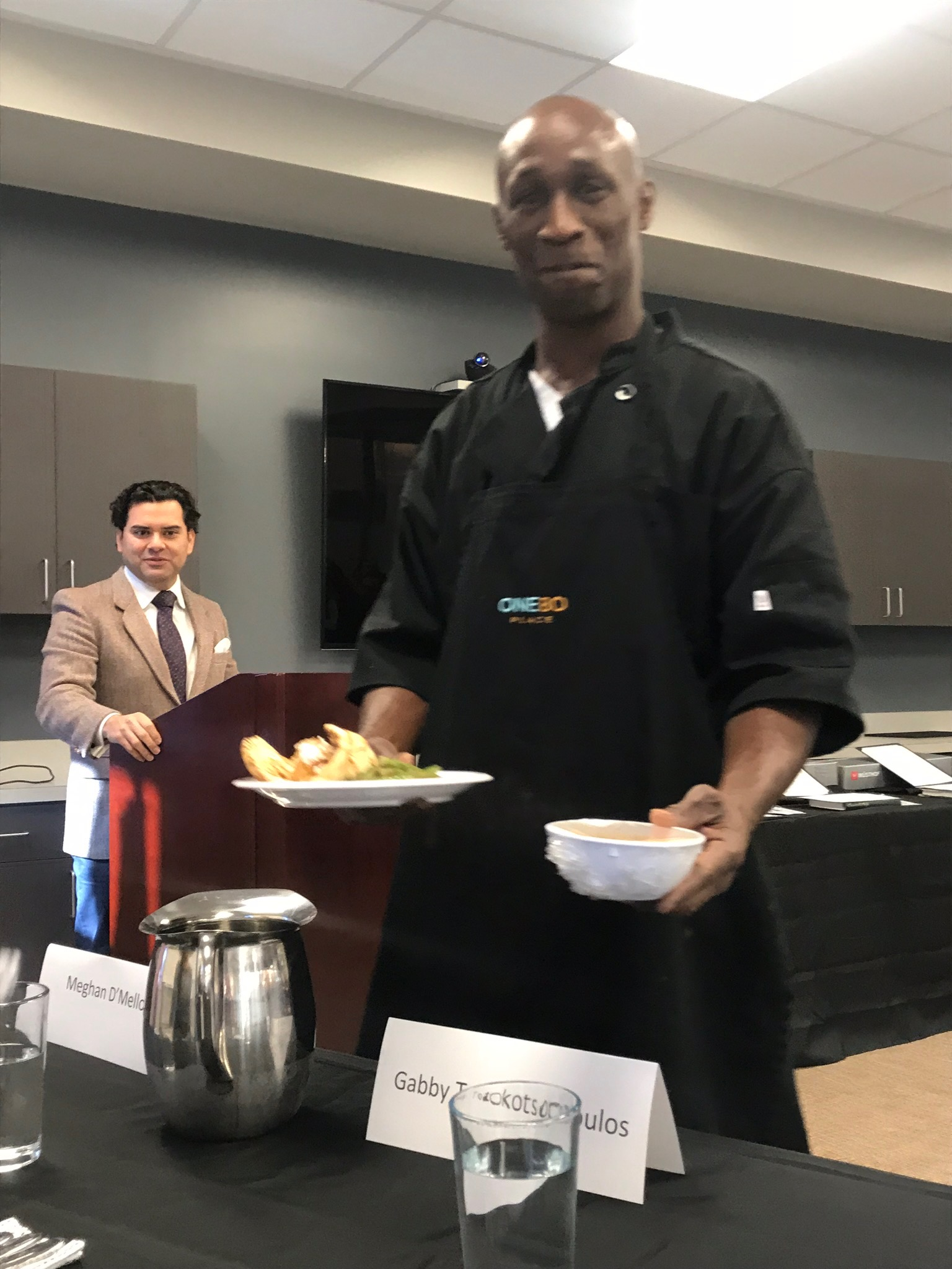 A new chef presents his dishes at One80 Place graduation.