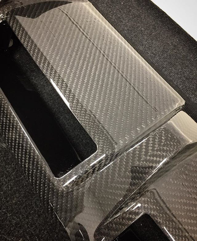 Close up of an Aston Martin aftermarket rear diffuser that we re skinned in carbon #fortiscomposites #carbon #carbonfibre #carbonfiber #carbonskin #composites #astonmartin #vantage #v #weave #shiny #gloss #lacquer #modball #modballrally #scd #supercar #v8