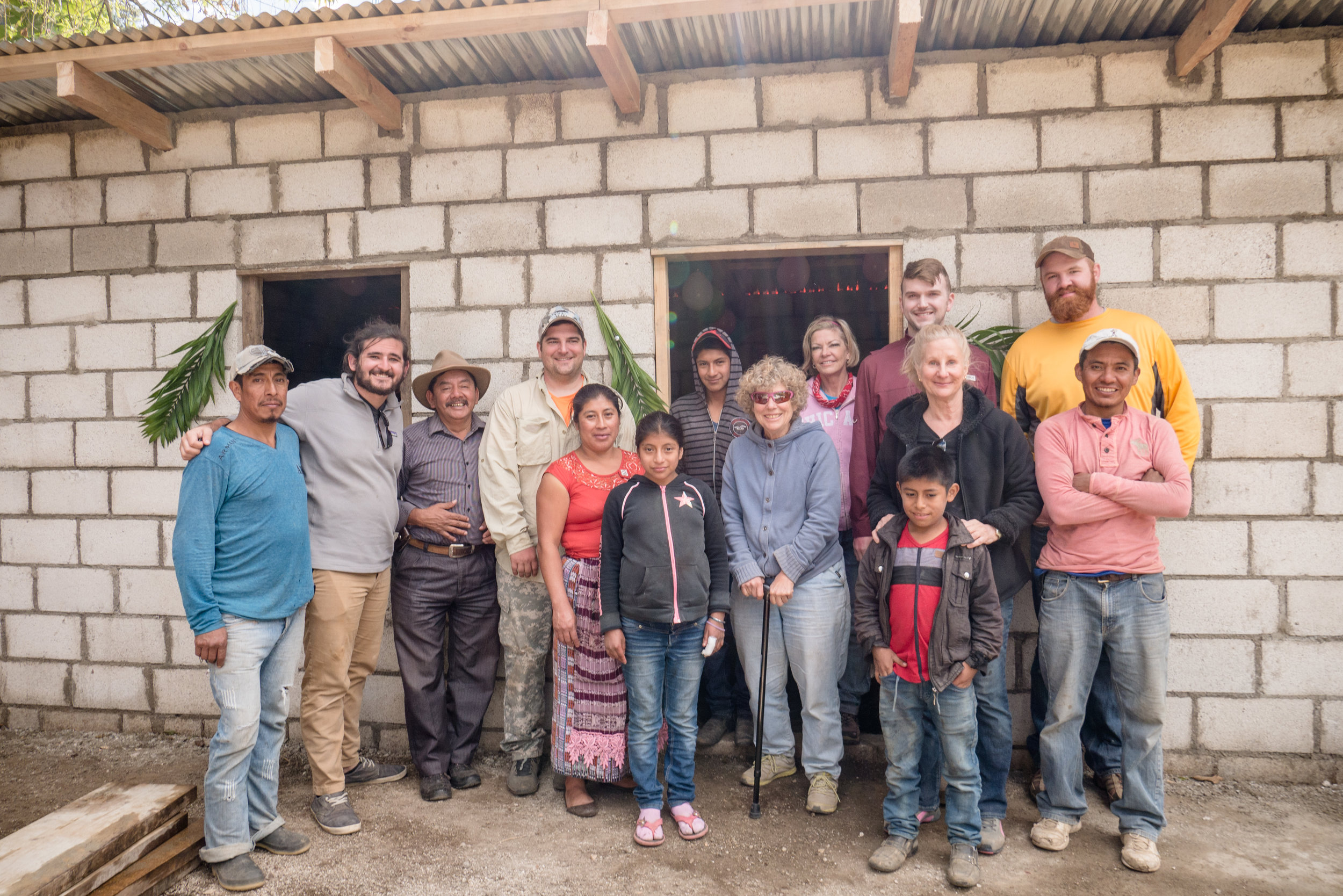 Juana and Her Daughter Pictured with the Mission Team, Teri, and Others