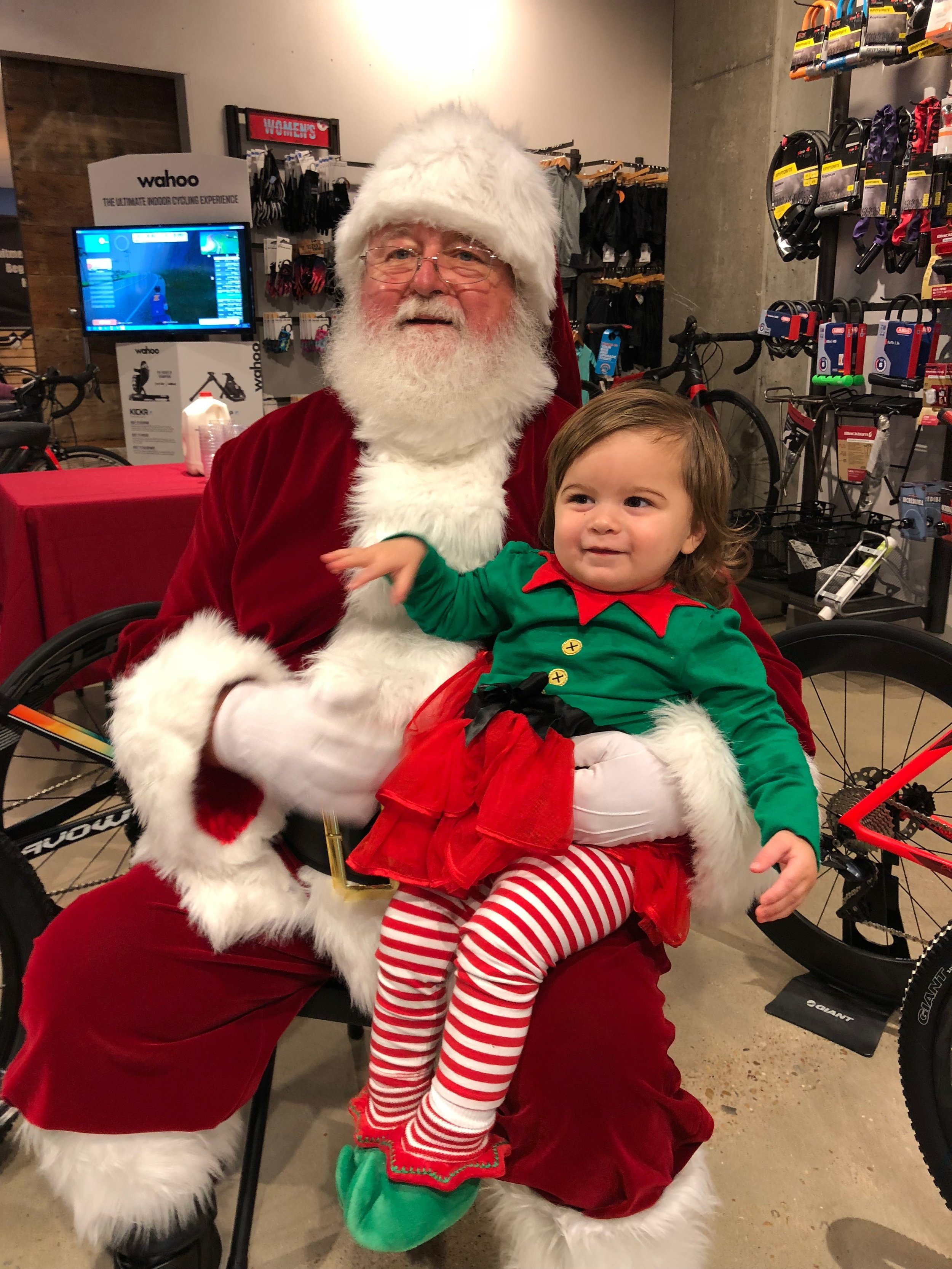 Adaline letting Santa (AKA her PaPa) know which toys from Bicycle World were on her wish list this year.