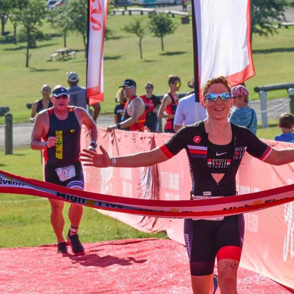 Crossing the finish line at The Rookie Tri in May.