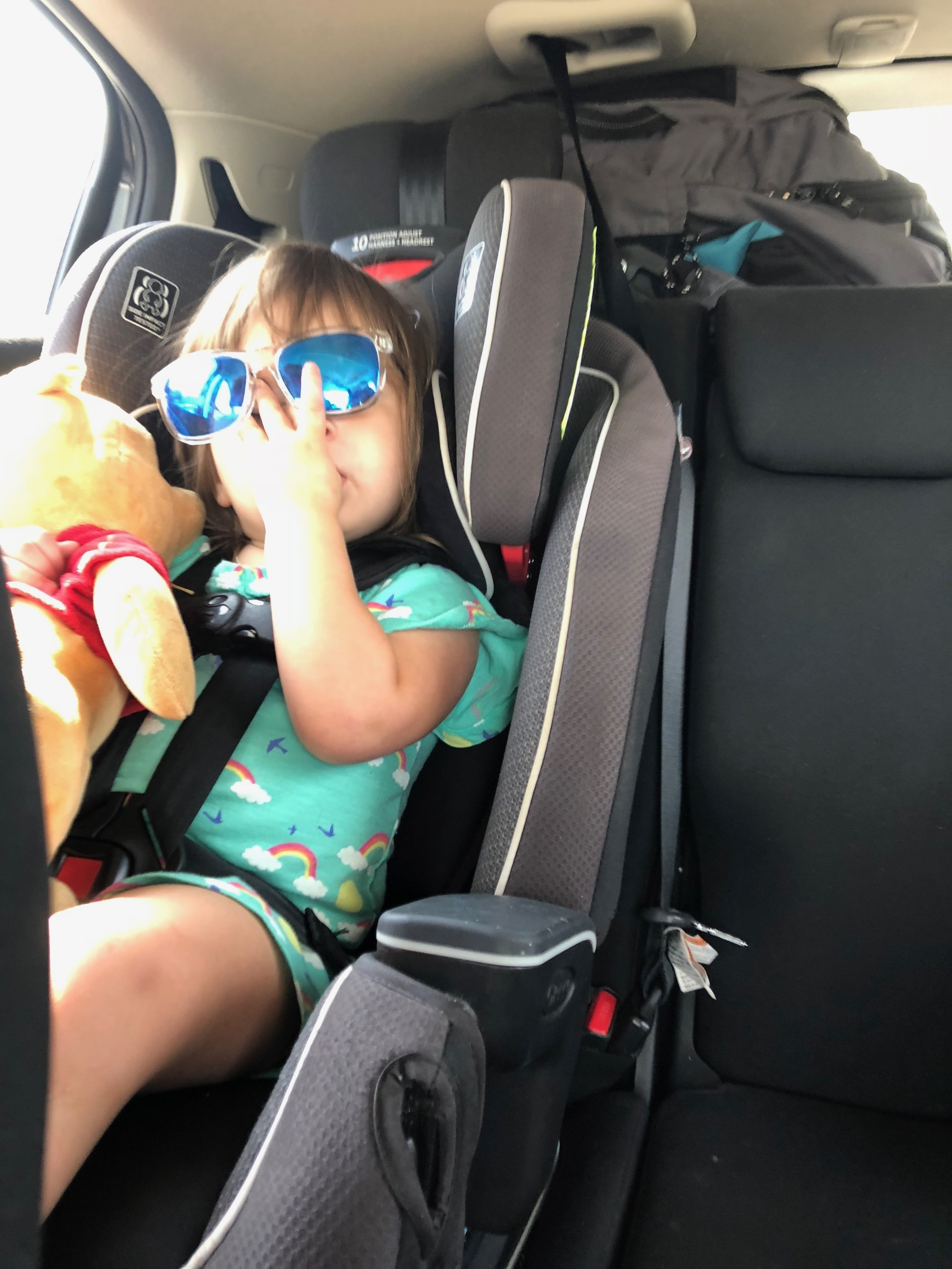 """Adaline and her """"Poohey"""" bear,cool as hell and ready for a six-hour road trip to Lubbock."""