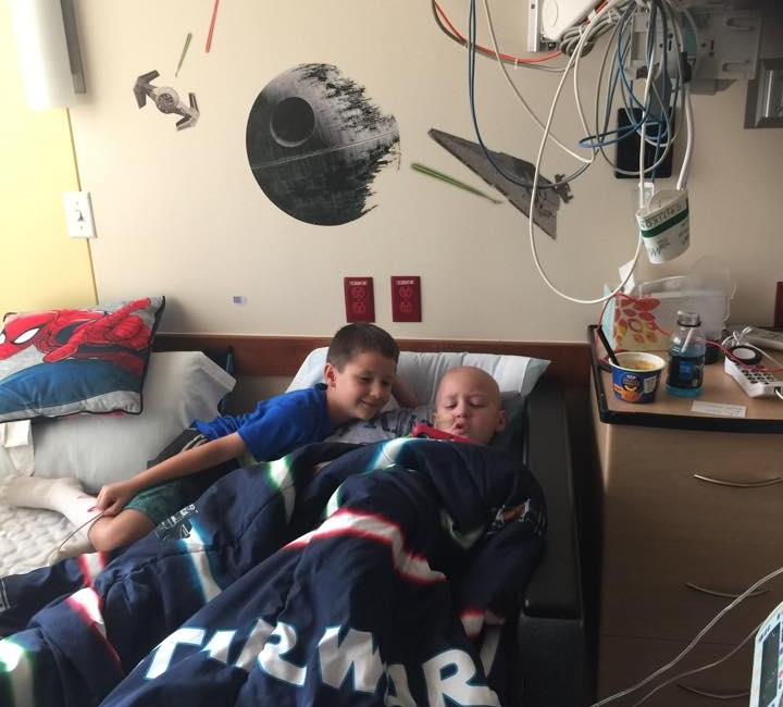 Jacob and his twin brother, Nathan, being kids as best they can at Dell Children's Hospital.