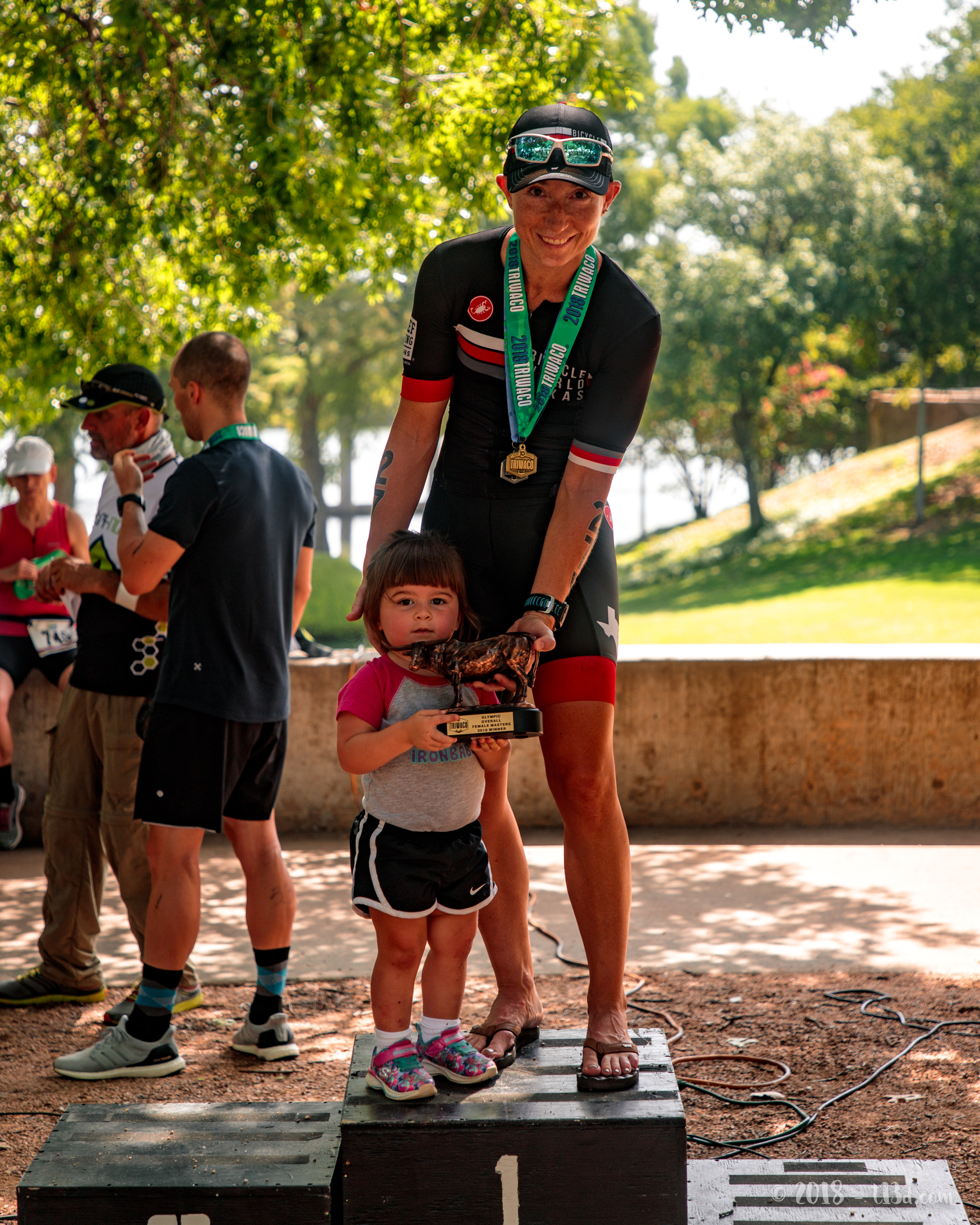 Adaline climbed up on the podium to help me with that heavy trophy. :) Photographer extraordinaire, Travis Swicegood, captured the perfect shot.