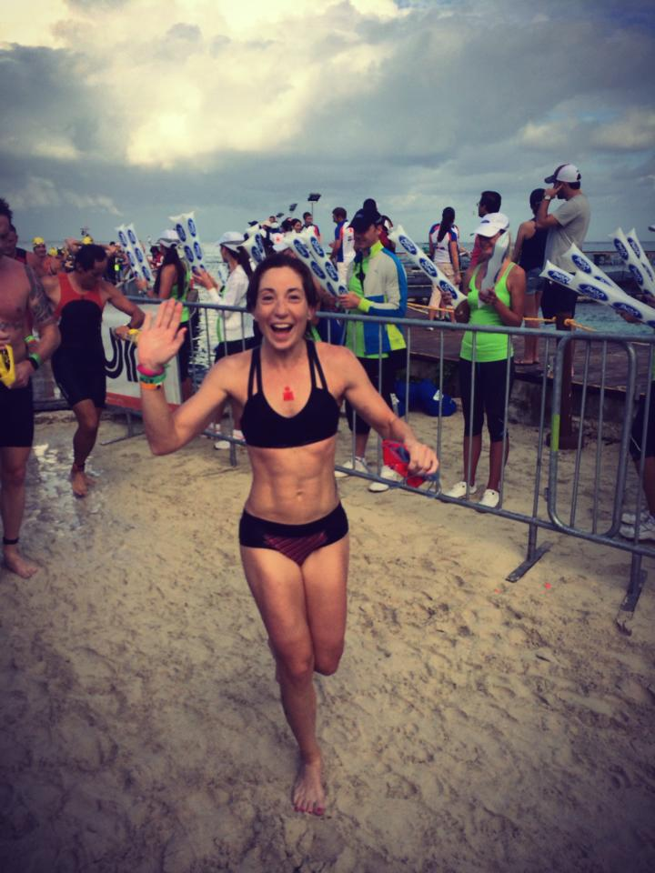"""Me at the swim exit at Ironman Cozumel in 2013, waving and blowing kisses to Travis while screaming """"I love you!"""""""