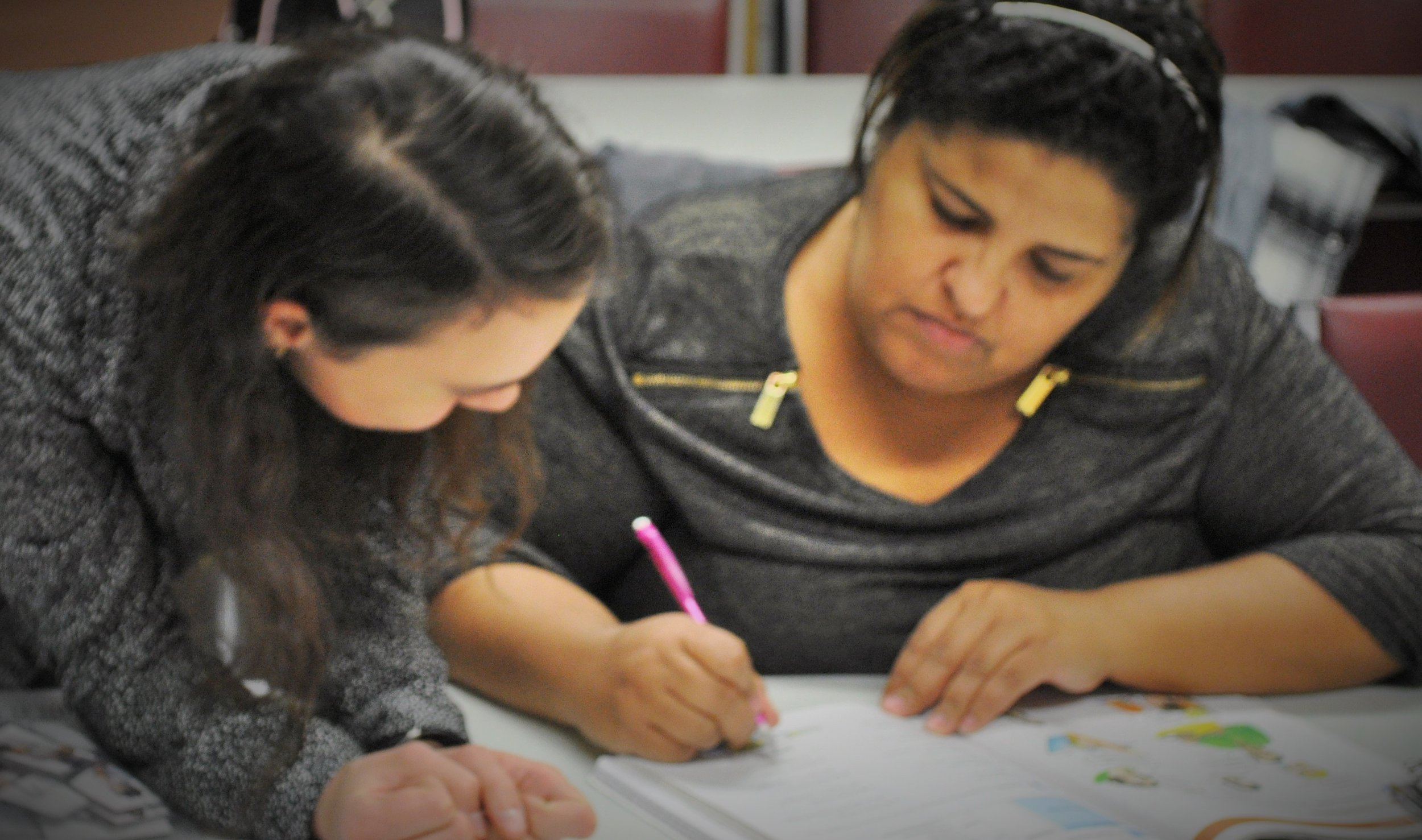 Life Together fellow Hannah Field works with an ESOL student during class. Photo by Elizabeth Kholer.