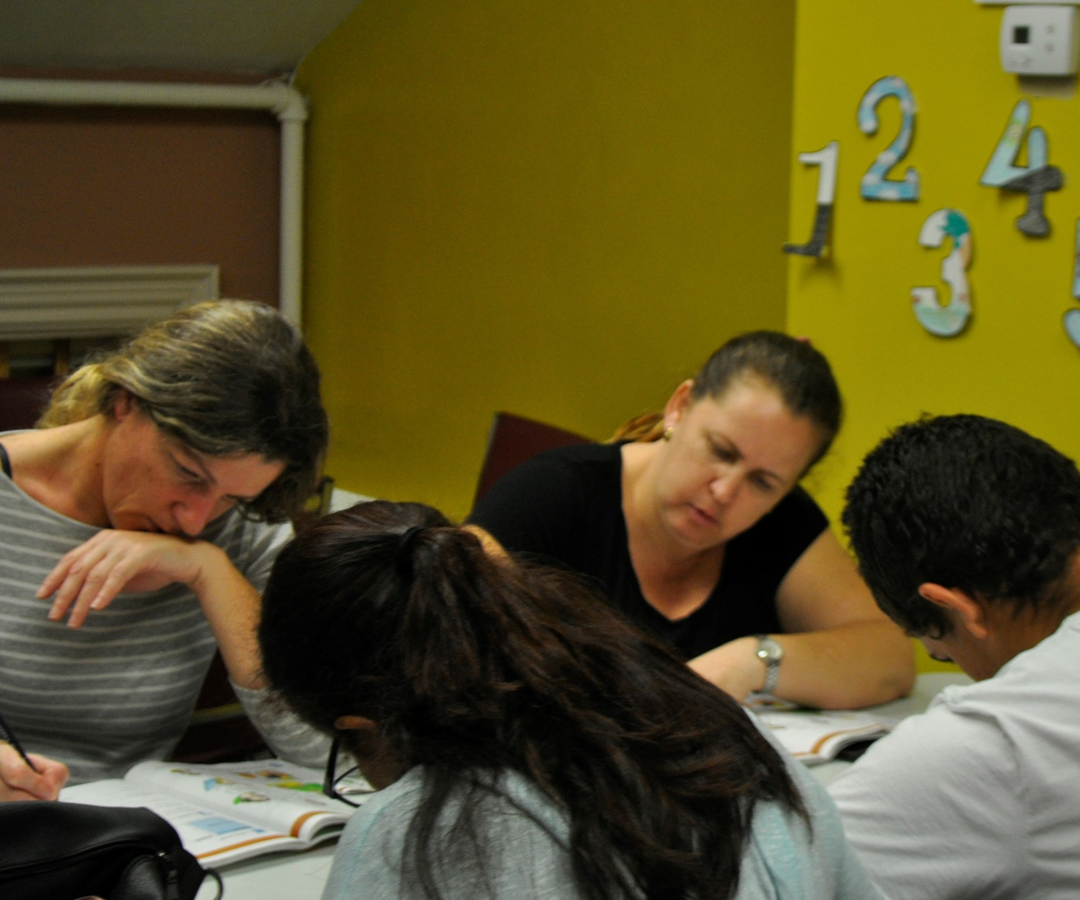 English Plus students at our Marlborough location work on activities about wellness and anatomy during class. Photo by Elizabeth Kholer.