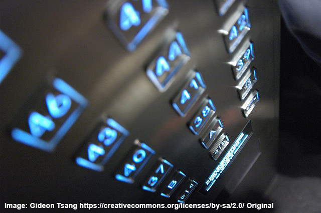 glowing elevator buttons