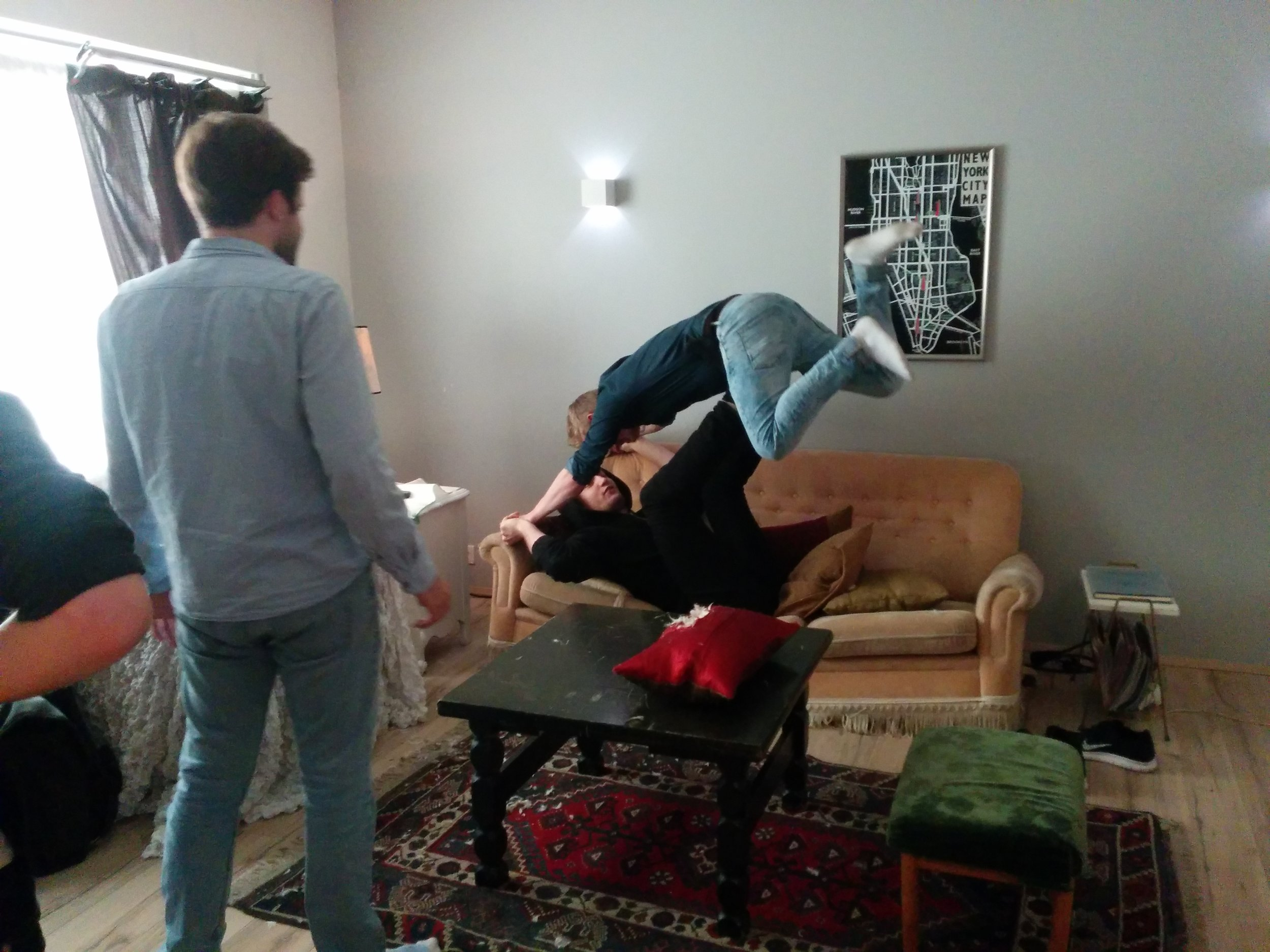 Director and stunt man practicing the fight scene.