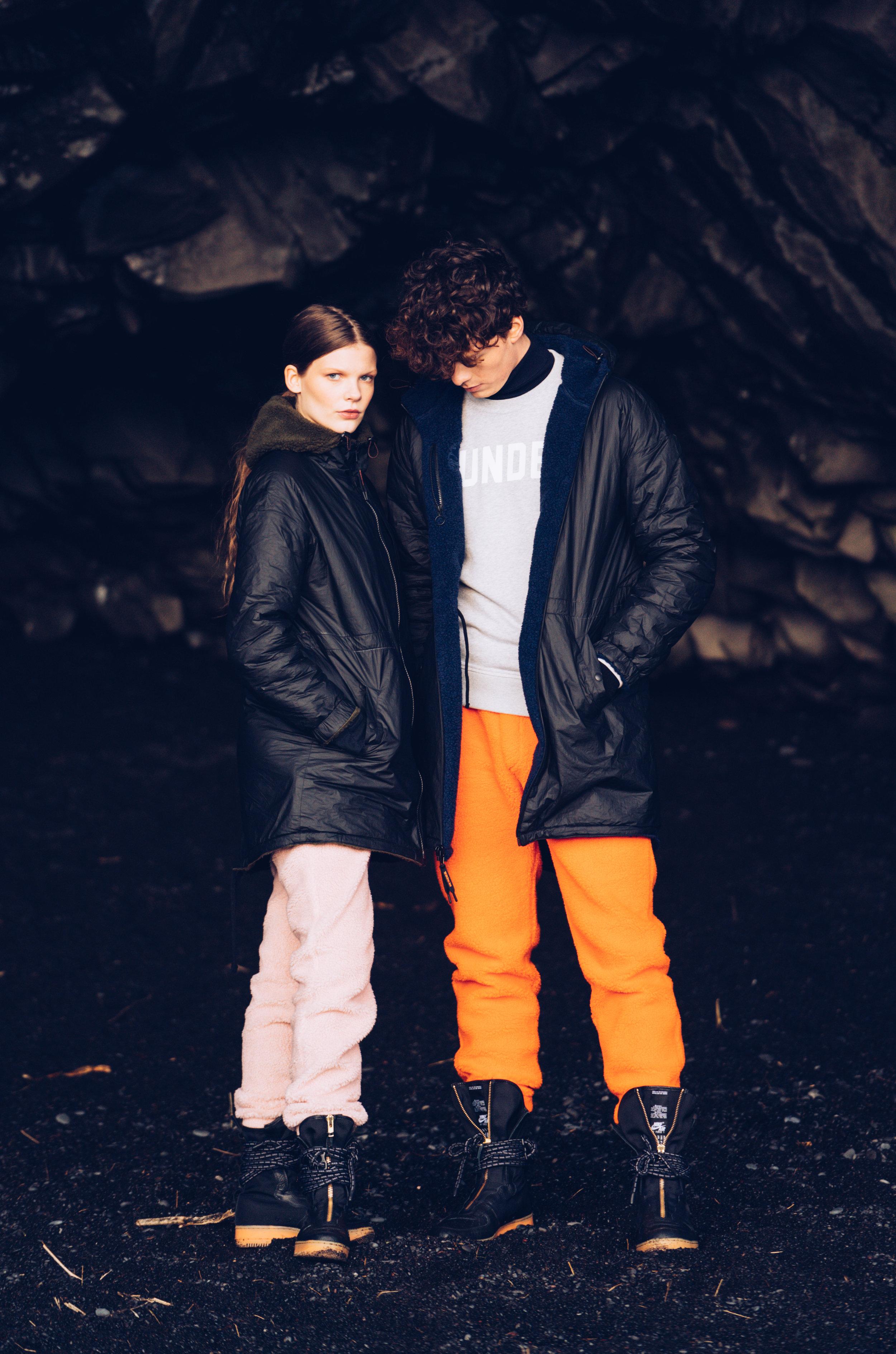 Sundek photoshoot Kristín and Sólon in a cave wearing reversed jackets