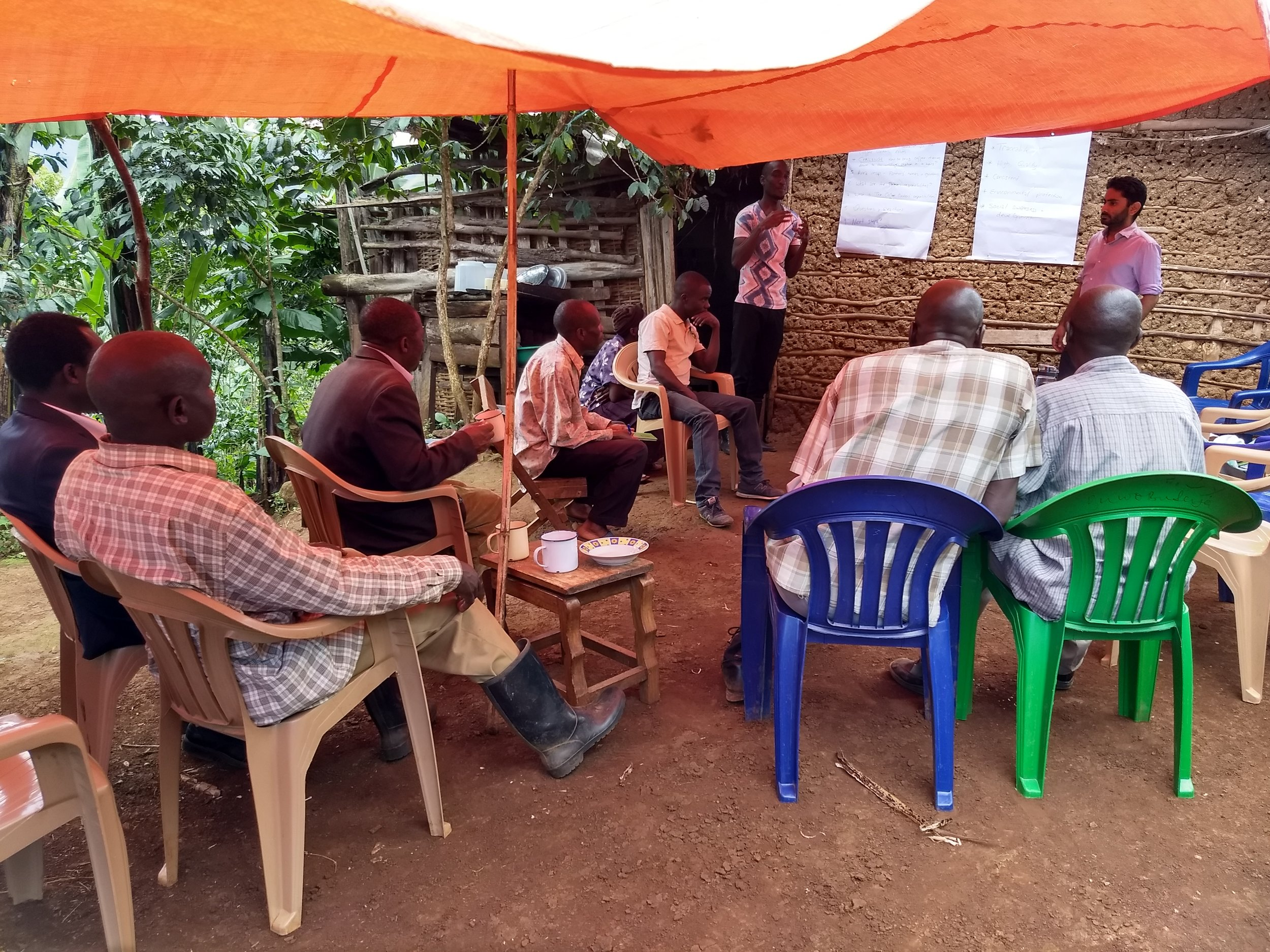 Farmers' meeting with The Coffee Gardens team ( Job and Shak L- R ) to discuss logistics of harvesting to ensure traceability and picking schedule.