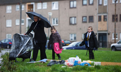 A young family with their mother in Easterhouse, Glasgow. Photograph: Murdo Macleod