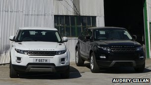 New 4×4 vehicles on garage forecourt are a sign of greater prosperity on the islands