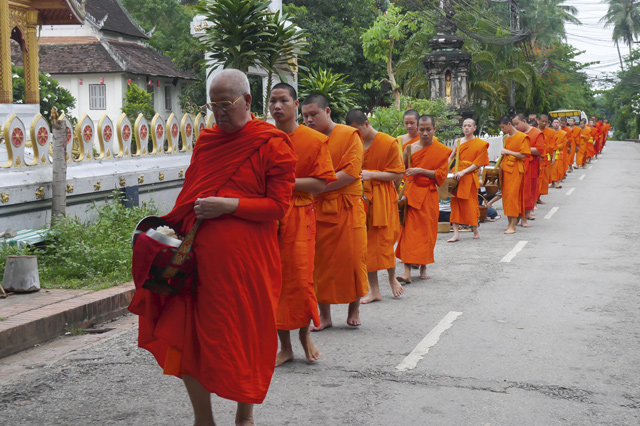 Monks seek alms at dawn