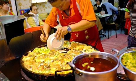 A cook prepares for the evening rush at one of Taipei's ever-popular street food markets. Photograph: Lap-Fai Lee