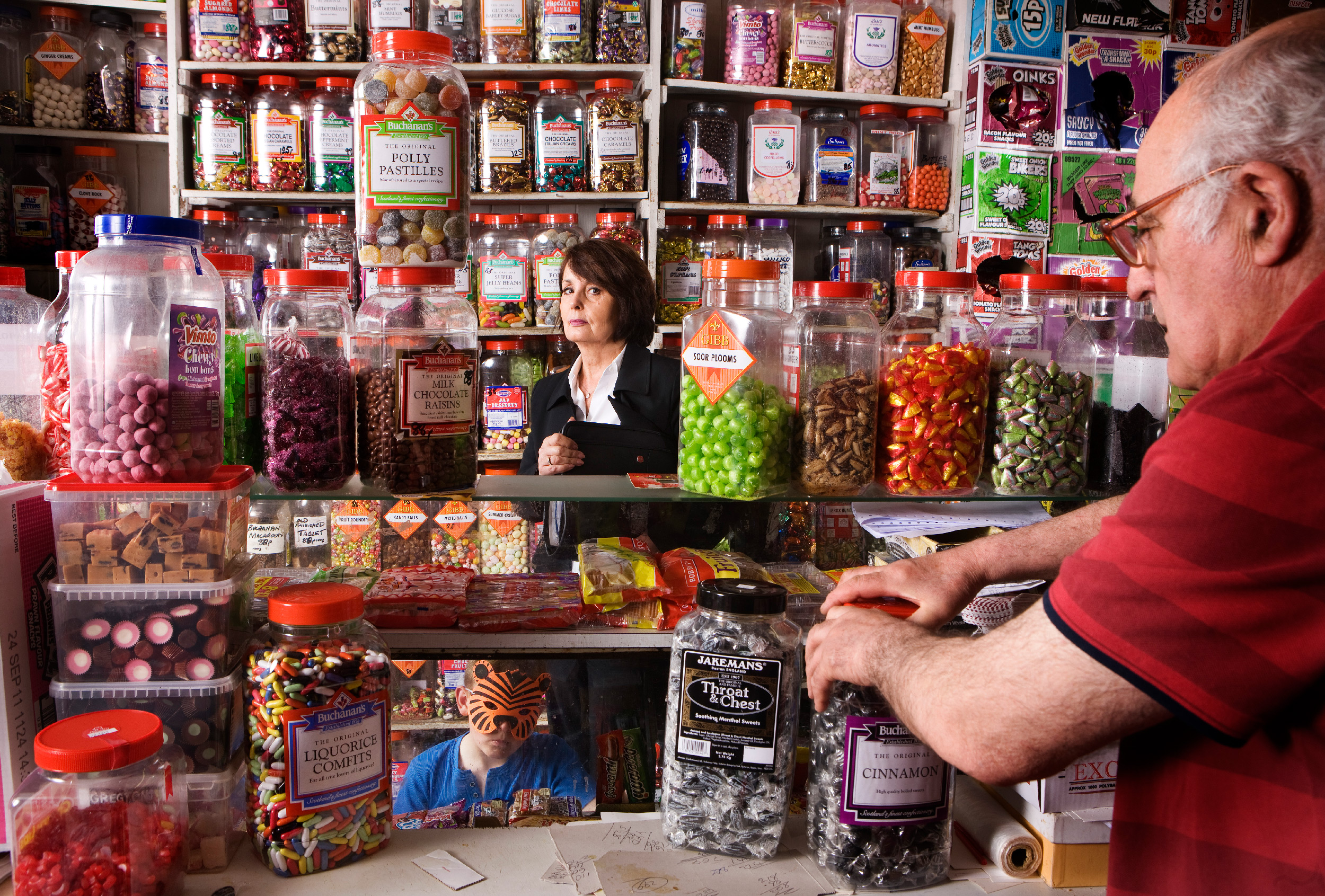 """Look at me standing next to the Soor Plooms with a soor face – that's just not me"": the writer's mother, Christine, in Tom Swan's Sweet Shop in Renton. Photograph: Murdo Macleod for the Observer"