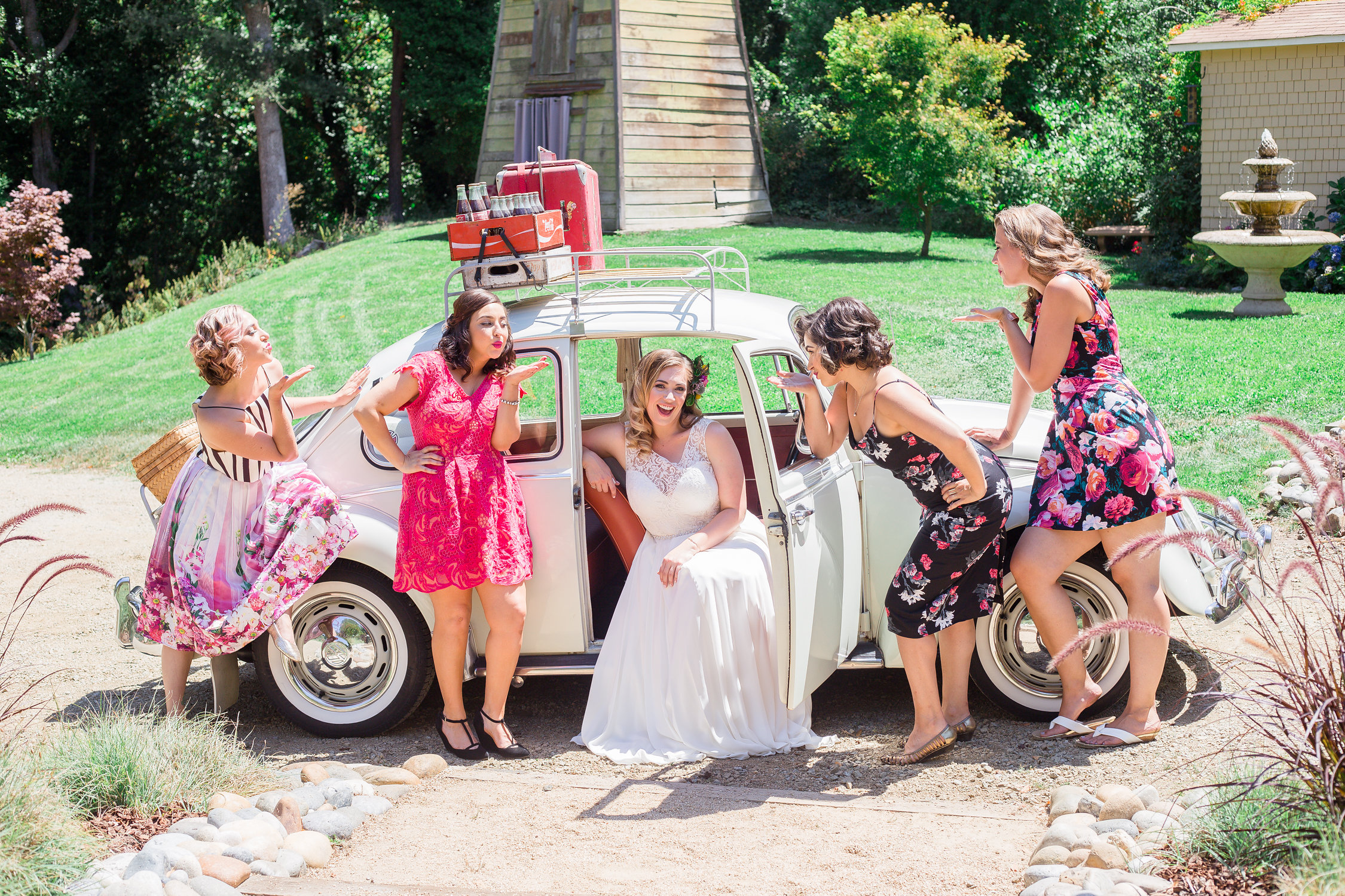 san jose california bridal and lifestyle makeup artist with friends at her wedding in bold floral dresses blowing kisses