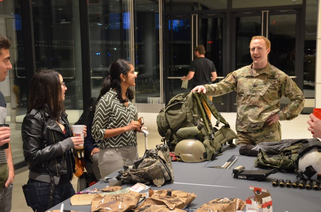 Demonstrating military gear & taste testing MREs at the Veterans Day Closing Bell