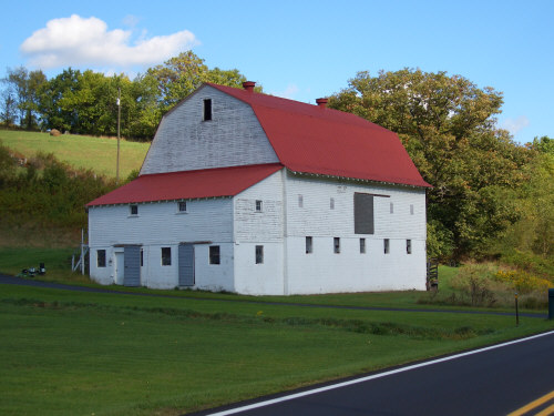 Large white Barn with red roof