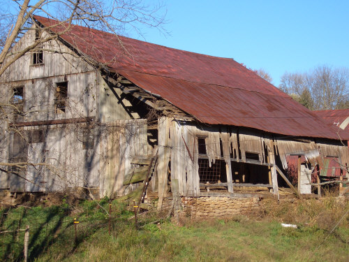 Well-weathered Barn with boards missing