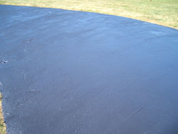 The finished driveway sealer coat should be uniform, without any clumps, ridges or missed spots. Block-off or flag all access points into the driveway to prevent vehicles and pedestrians from entering. Most sealers need at least 24-hours to dry before they are ready for any sort of heavy traffic. Keep pets away from wet sealer!