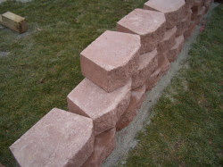 Running bond - For maximum wall strength use a 'running bond' alignment (like seen with a brick wall on a house). In other words, cover joints between stones by placing wall stones above them so they straddle the joint below. This construction arrangement helps 'lock' the wall together. Avoid lining up joints with one joint above another!