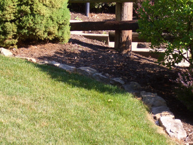 Natural Stone - (Rough cut stones buried end to end)