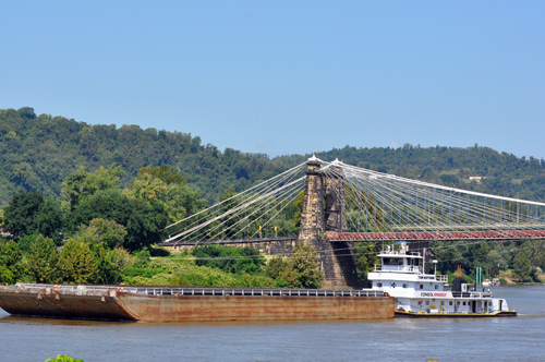 A towboat with barges moves down the Ohio River near Wheeling, West Virginia.