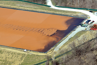 """""""THE DEVIL'S BACKBONE""""   Marcellus shale wastewater pit holding fluids that have returned from the deep, radioactive shale. Childhood cancer clusters have emerged in SW Pennsylvania, fifteen years after fracking began. Ewing sarcoma is the most notable one."""