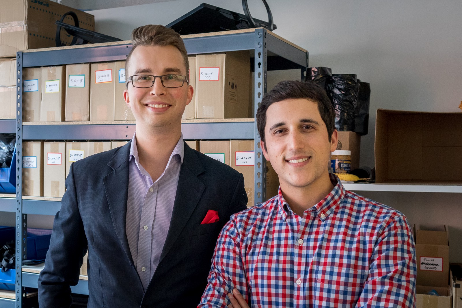 Hinge Health cofounders, Gabriel Mecklenburg and Daniel Perez, in our fulfillment center