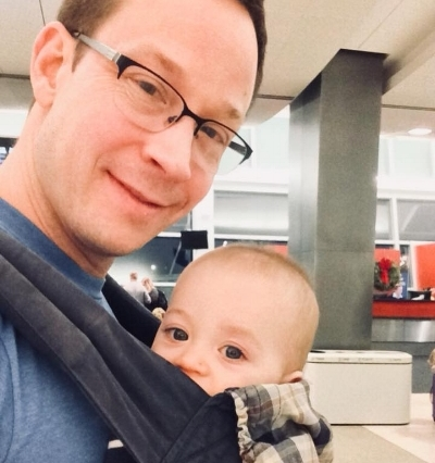 My husband braving Seatac airport alone with our infant. He posted this photo to Facebook, where dozens of commenters agreed: He is such a great dad!