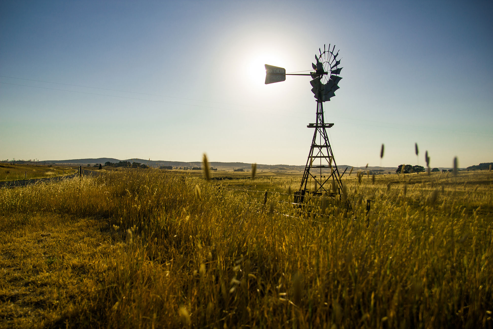 bigstock-Windmill-Silouhetted-In-Rural--81626480.jpg