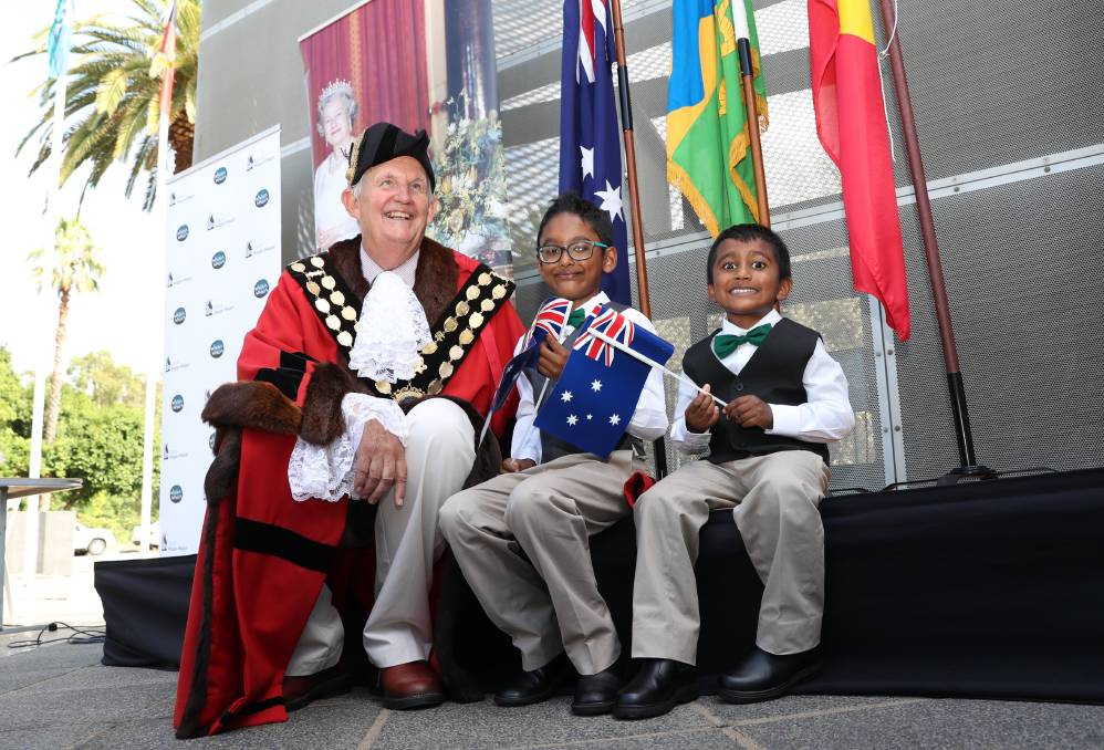 Mayor Greg Conkey with new citizens Marcus Daniel, 7, and Derrick Daniel, 4, at this year's Australia Day citizenship ceremony at the Victory Memorial Gardens. Picture: Les Smith