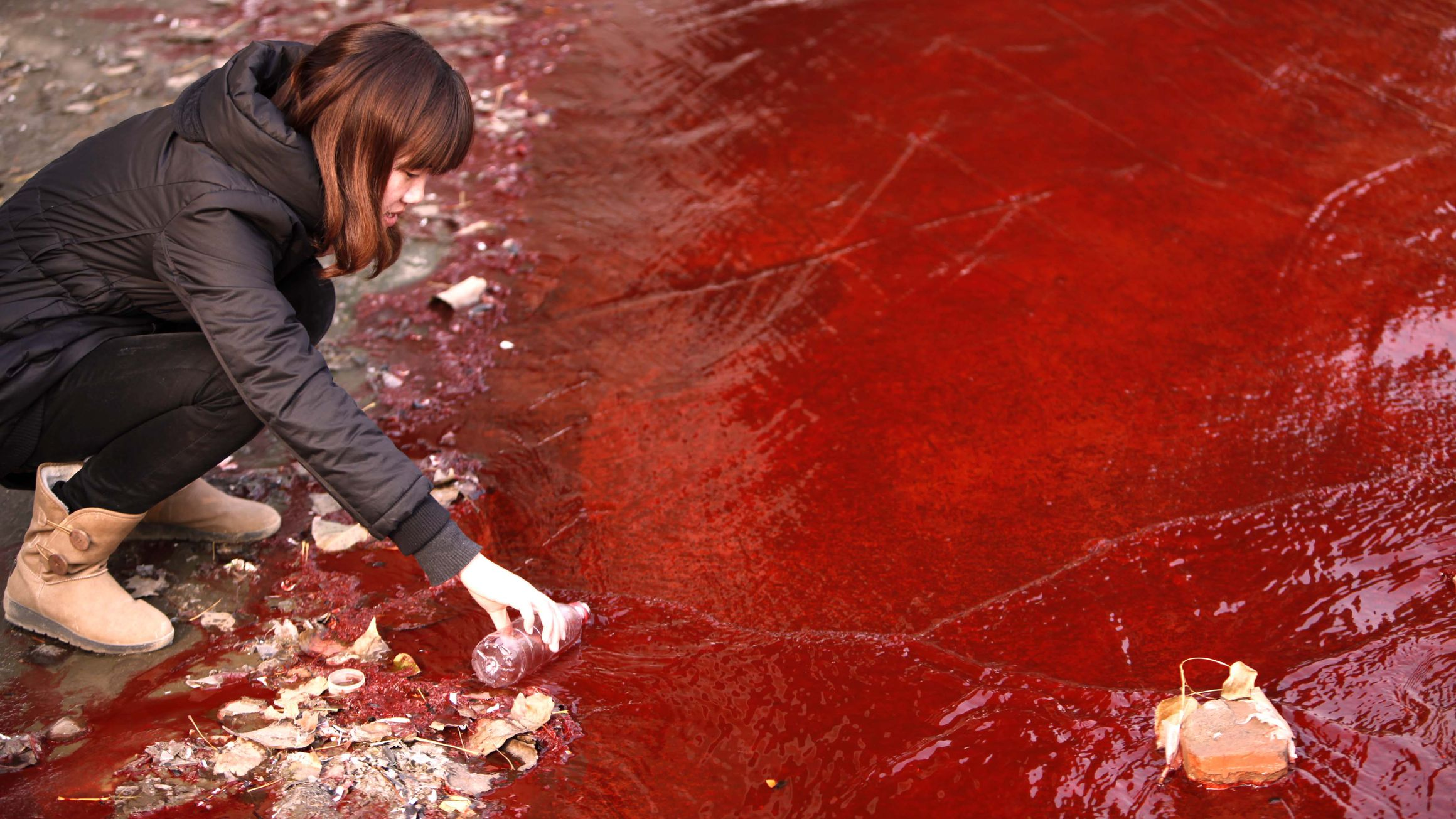 A heavily polluted stream in China, a direct result from chemical dye discharge.