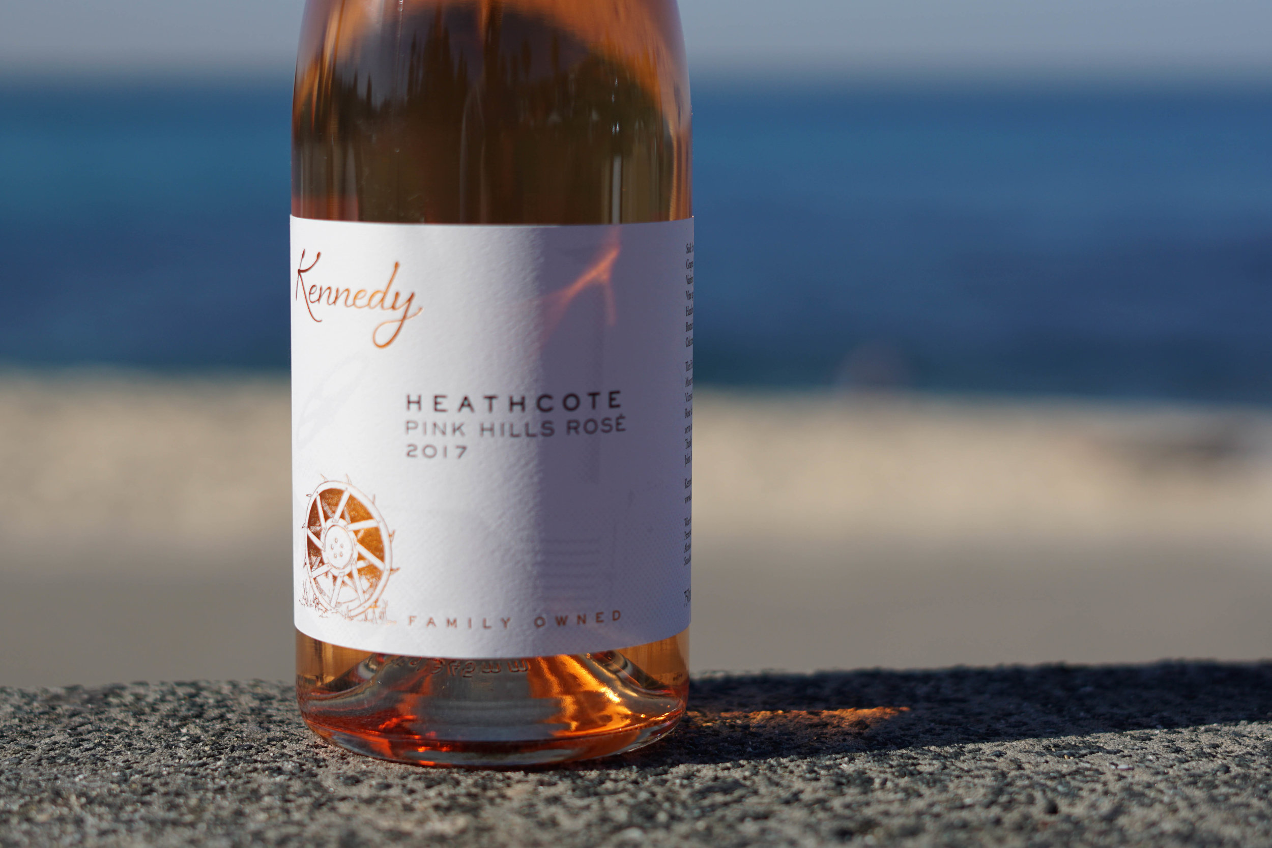 2017 Kennedy 'Pink Hills' Rosé   100% Mourvedre 2.5T/acre  Handpicked at 240m elevation on Cambrian soils (Iron rich with jasper, chert, seafloor basalt/greenstone). Mourvedre is wholebunch pressed direct to old French barrique to complete wild primary fermentation for a little over 14 days with occasional battonage towards the end of ferment.  Post wild primary fermentation, the wine is lightly sulphured to prevent malolactic fermentation occuring. The resulting wine is round and textured thanks to barrel fermentation but retains a pristine line of acidity. The wine remains on lees for 7 months in old french barriques before being sent to bottle without correction.  Bottled unfined and unfiltered with 55mg/l SO2 added.
