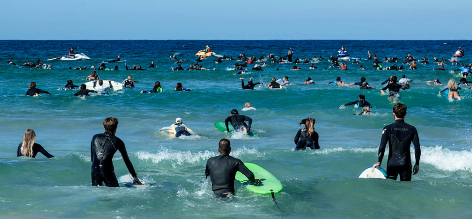 Surfers paddling out through the breakers at Bondi Beach in Sydney, Australia, on Sunday in protest against oil and gas drilling in the Great Australian Bight. Credit: Anna Maria Antoinette D'Addario for The New York Times
