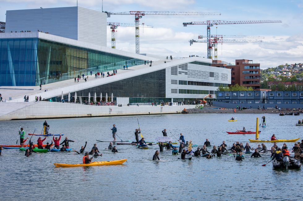 Photo: Siri Øverland Eriksen  The paddle out near the Opera House, Oslo