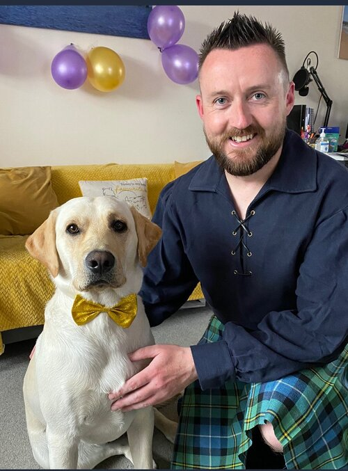 Community Champion finalist Kevin Paterson, from Police Scotland, is dressed to impress for the event with his Labrador Connor.