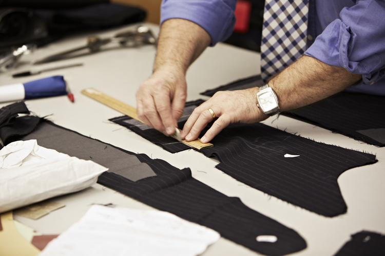 3.  YOUR CLOTH IS CUT AND HAND-STITCHED - Once you have chosen your cloth, we have taken your measurments and discussed your personal design of the suit, the next stage is cutting the cloth and making a shell of your jacket, this will then be fitted to you in your second visit.
