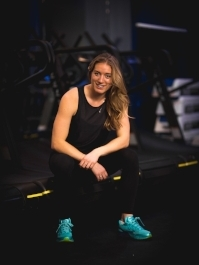 """RACHEL HALL  Wrapped up in that small but mighty package is a powerhouse both in strength and smarts. This UofC Varsity wrestler lives and breathes health and wellness, and is coming to us from years of personal training and group fitness coaching. Rachel also doubles as our Training Lead bringing such depth in knowledge to the table. Just like many of us, Rachel turned to cross training to supplement sport and ultimately feed her soul: """"through injuries, mid terms and break ups working out was my go to stress reliever, I knew I wanted an excuse to be able to workout always.""""  Known for sneakily (but safely) getting you to that next level, Rachel is all about concrete technique while cracking the odd joke or five. Count on walking out with a couple of personal bests and all of the high fives.   Vibe: A good remix of the oldies but goodies.Something you can sing along to, groove to and of course sweat it out to.   Currently Crushing: Right now I am working on learning how to take care of myself, what are my limits, how much sleep do I need at night and what foods make me feel energetic? All questions I am taking the time to work out with the help of other professionals in my field, books and quiet time.    And I quote:   """" Be fearless in the pursuit of what sets your soul on fire."""""""