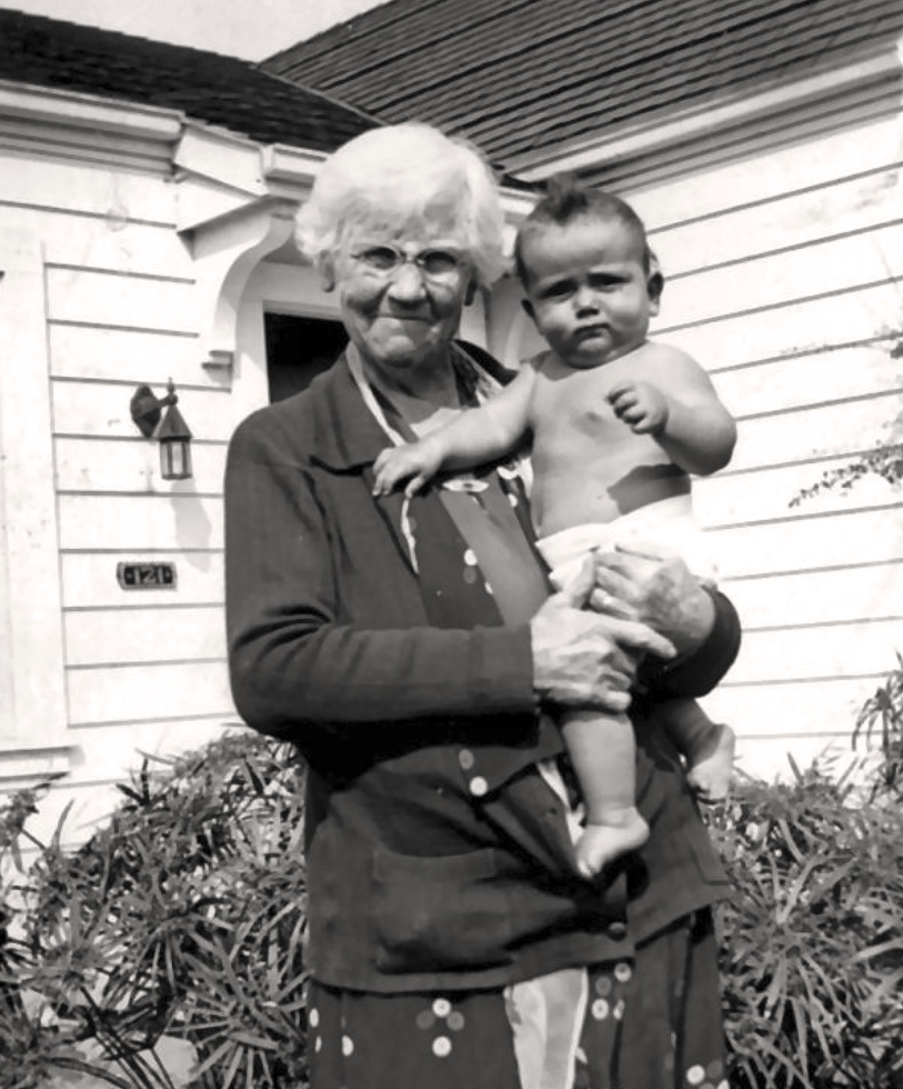 Virginia C. Arnott, founder and first club president, in 1932 with her ten-month-old grandson, Peter Arnott, Jr. At the age of 3, Peter would help raise the flag during the 1935 dedication ceremonies.
