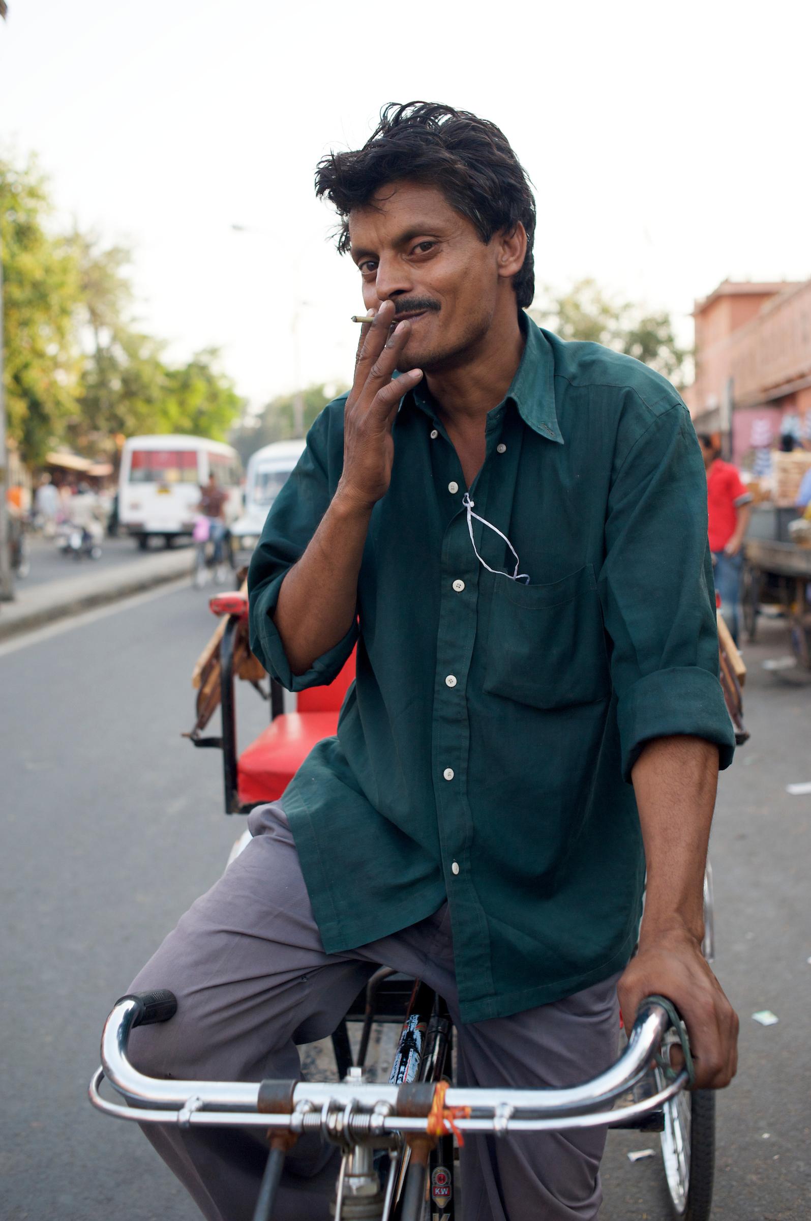 Rickshaw Wallah and tourist hawker - Jaipur, India