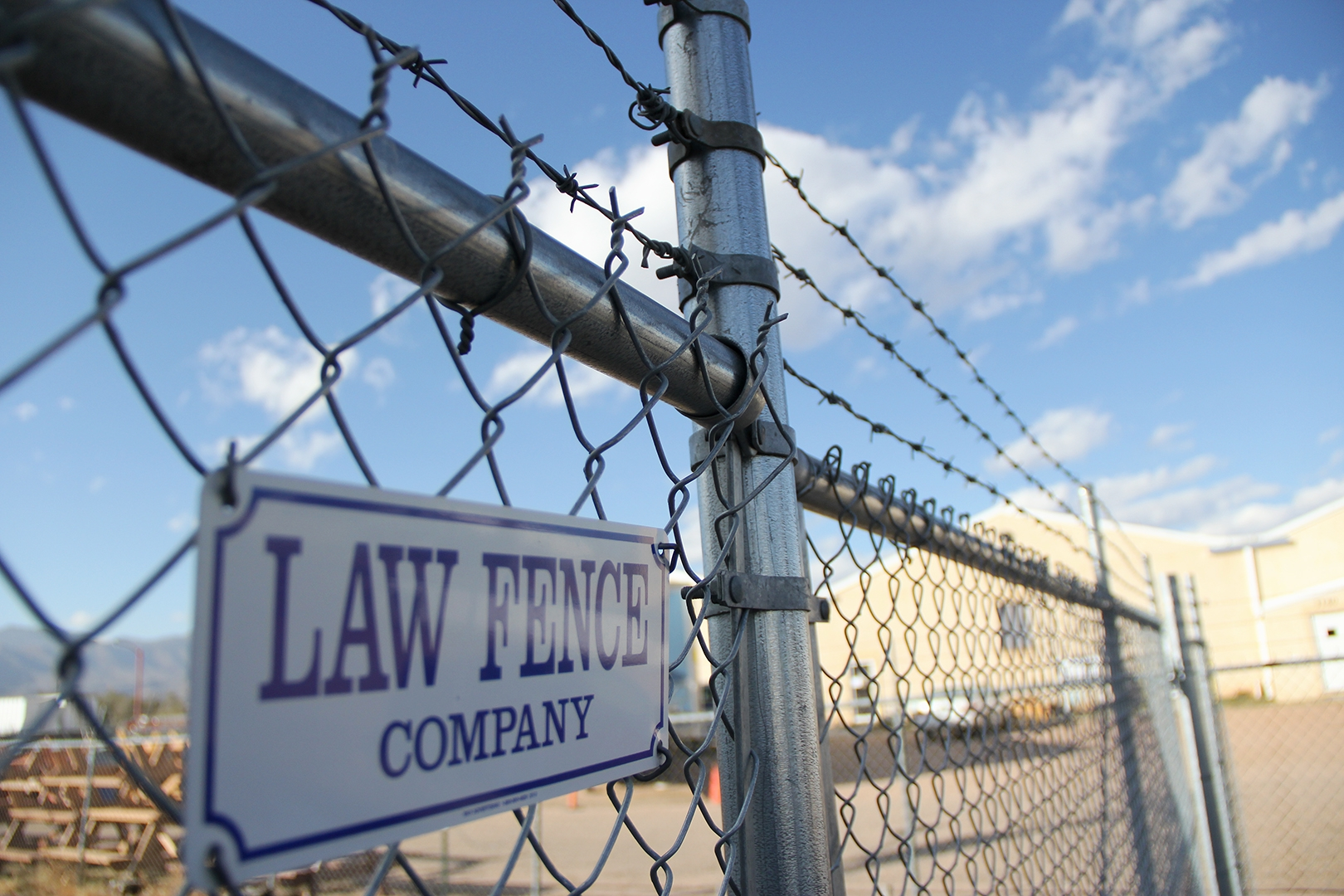 Custom Chain Link Fence with Barbed Wire Colorado Springs