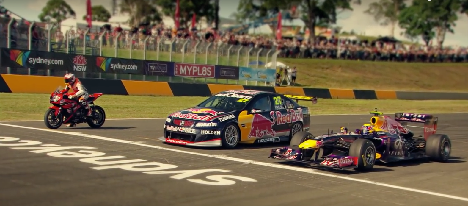 One of TopGear's many tests showcases some of the differences between various race cars that are likely to have completely different suspension frequencies. The Touring car in the middle likely has a 3.0-3.5Hz suspension frequency with it's simple aero package and race tires, while the F1 car will have a frequency in excess of 5.0Hz, as its downforce produced and ultimate grip level is far greater. The bike will run off the same principles as a car's suspension.